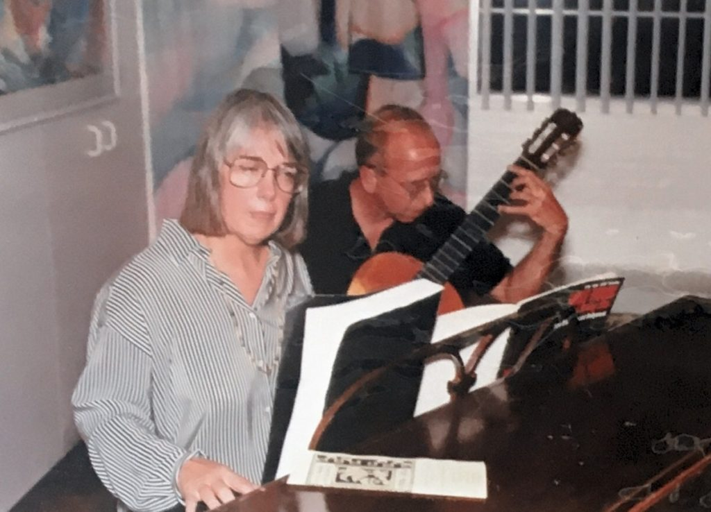 1992-93 woman playing piano and man playing guitar