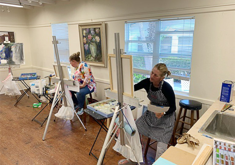two women painting at a BGAC workshop