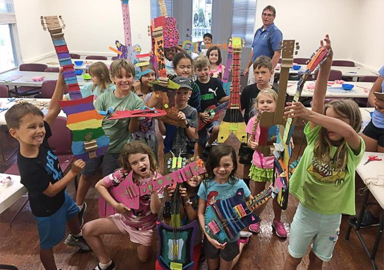 Island School Kids showing off their art projects
