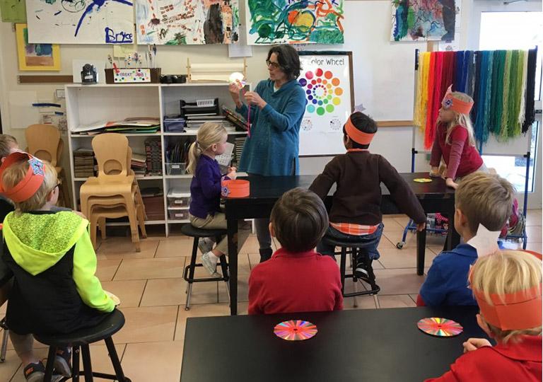 art teacher in front of class