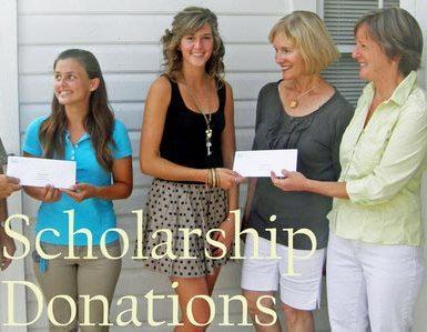one man and three women holding checks