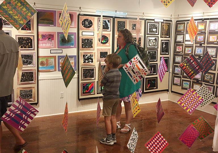 mother and son visiting a student art exhibit