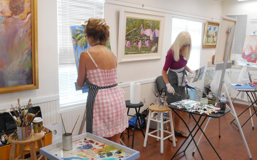 Two women participating in a painting class