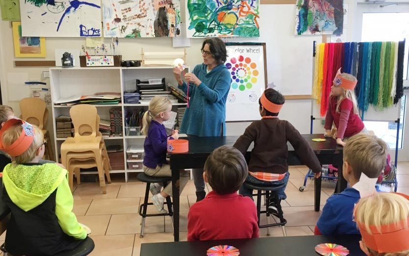 Woman teaching art to preschoolers